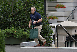 Outgoing White House Spokesman Sean Spicer walks into the West Wing of The White House in Washington, DC, July 29, 2017. Credit: Chris Kleponis / Polaris /Pool/ABACAPRESS.COM