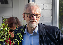© Licensed to London News Pictures. 14/12/2019. London, UK. Labour Party Leader Jeremy Corbyn and his wife Laura Alvarez leave home on the day after the election. The Conservative Party have won an 80 seat majority in the general election. Mr Corbyn has said he will stand down when a new leader is elected. Photo credit: Peter Macdiarmid/LNP