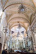 Interior view of the Baroque style, Parroquia de Basílica Colegiata de Nuestra Señora de Guanajuato or Guanajuato Basilica in the historic center of Guanajuato City, Guanajuato, Mexico. The massive basilica was built in 1671 and contains a jewel incrusted image of the Virgin Mary.