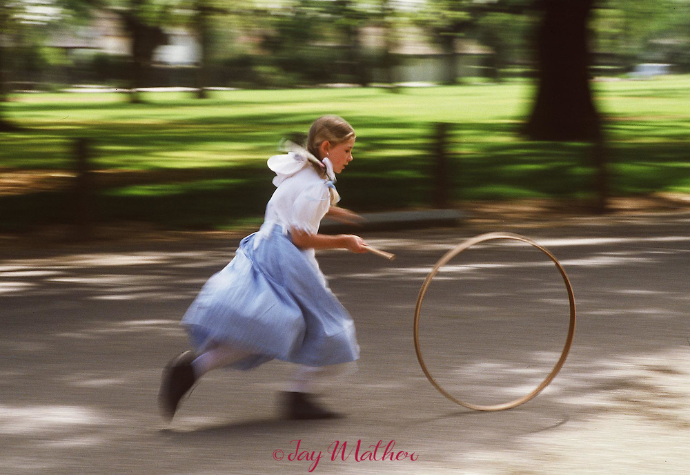 """Recess at the Pioneer School in Elk Grove, CA means a game of """"stick and hoop"""" for a student.  All the elementary school students spend a week studying the history of the early settlers to the area,"""