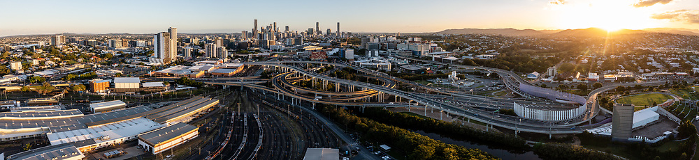 Panoramic aerial view of the Inner City Bypass & Airport Link highway interchange with Brisbane City in the distance, Bowen Hills, Brisbane, Queensland, Australia