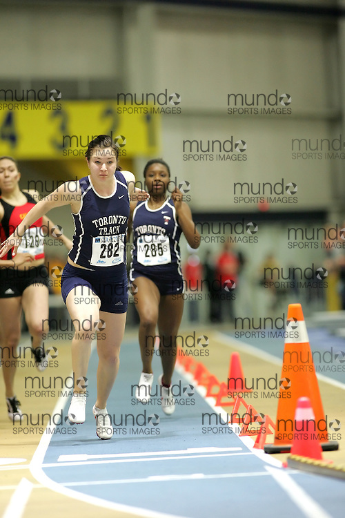 (Windsor, Ontario---12 March 2010) Jessica Caterini of University of Toronto   competes in the 4x200m relay heats at the 2010 Canadian Interuniversity Sport Track and Field Championships at the St. Denis Center. Photograph copyright Sean Burges/Mundo Sport Images. www.mundosportimages.com