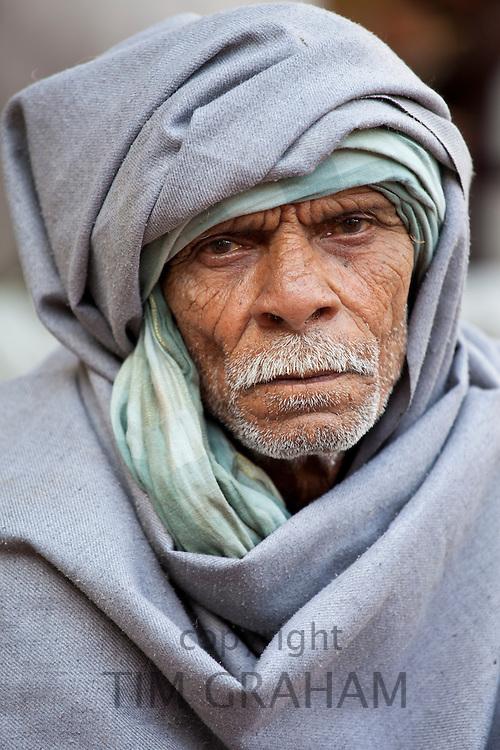Hindu Indian man in Old Delhi at  Daryagang market, India