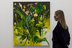 """© Licensed to London News Pictures. 03/12/2020. LONDON, UK. A staff member poses with """"Say Her Name"""", 2017.  Preview of """"Jennifer Packer: The Eye Is Not Satisfied With Seeing"""" at the Serpentine Gallery.  It is the American artist's first exhibition in a European institution and includes paintings and drawings from the past decade alongside recent works.  The exhibition opens to the public on 5 December. Photo credit: Stephen Chung/LNP"""