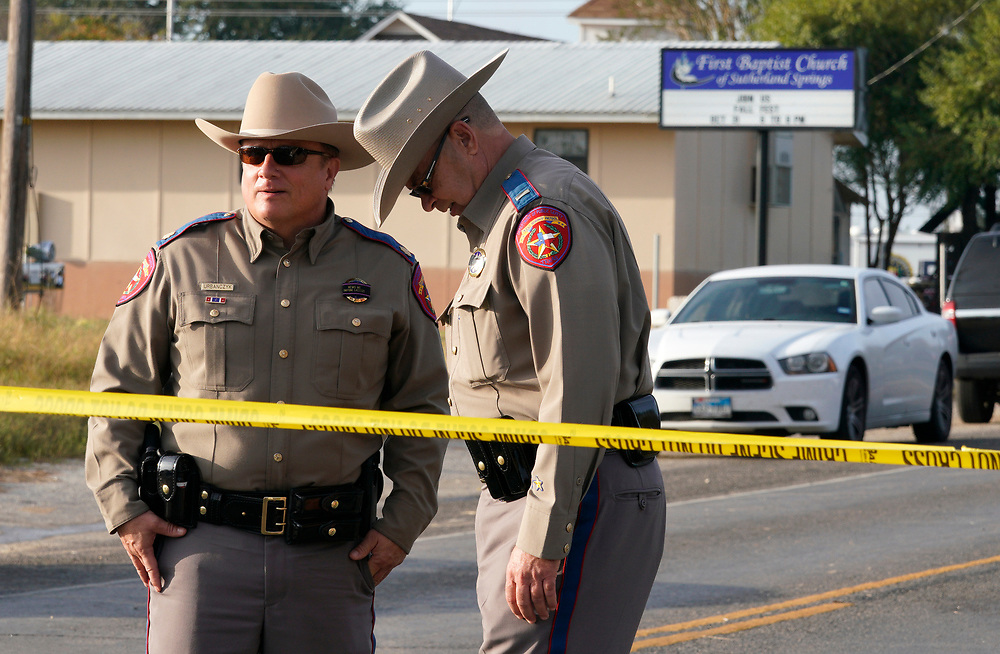 Police stand outside the site of a shooting at the First Baptist Church of Sutherland Springs, Texas U.S. November 6, 2017.  REUTERS/Rick Wilking