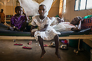 DRC / Burundi Refugees / 30-year old Ndaysenga and their children seat on their bed at a hospital in DRC's<br /> South Kivu Province where they are being treated. Two of her children suffer from<br /> malaria and the youngest who is just one-year old suffer from an abscess on his<br /> neck.<br /> <br /> 7,661 Burundians refugees have crossed into the DRC over the past few weeks. The new<br /> arrivals are being hosted by local families, but the growing numbers are straining<br /> available support. UNHCR is helping some 500 vulnerable refugees at a transit centre<br /> at Kavimvira and in another centre at Sange. Work is ongoing to identify a site<br /> where all the refugees can be moved, and from where they can have access to<br /> facilities such as schools, health centers and with proper security. / UNHCR / F.Scoppa / May 2015