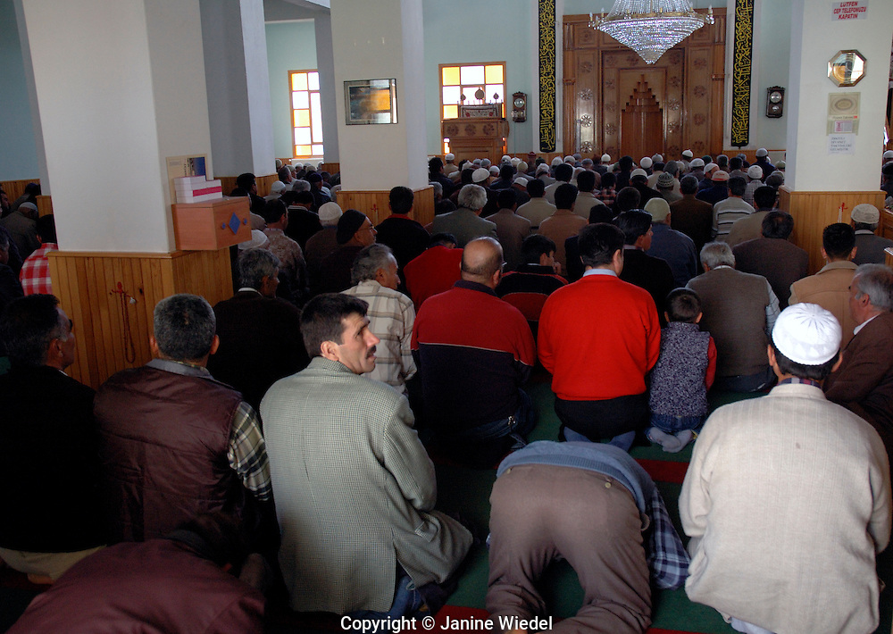 Muslim men praying inside Mosque in village of Gombe in Anatolya Southern Turkey.