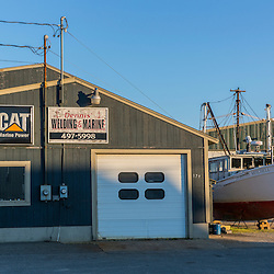 Dennis Welding and Marine is across the street from Great Wass Lobster. It is one of many businesses in the Jonesport/Beals area dependent on the local fishing industry. Beals, Maine.