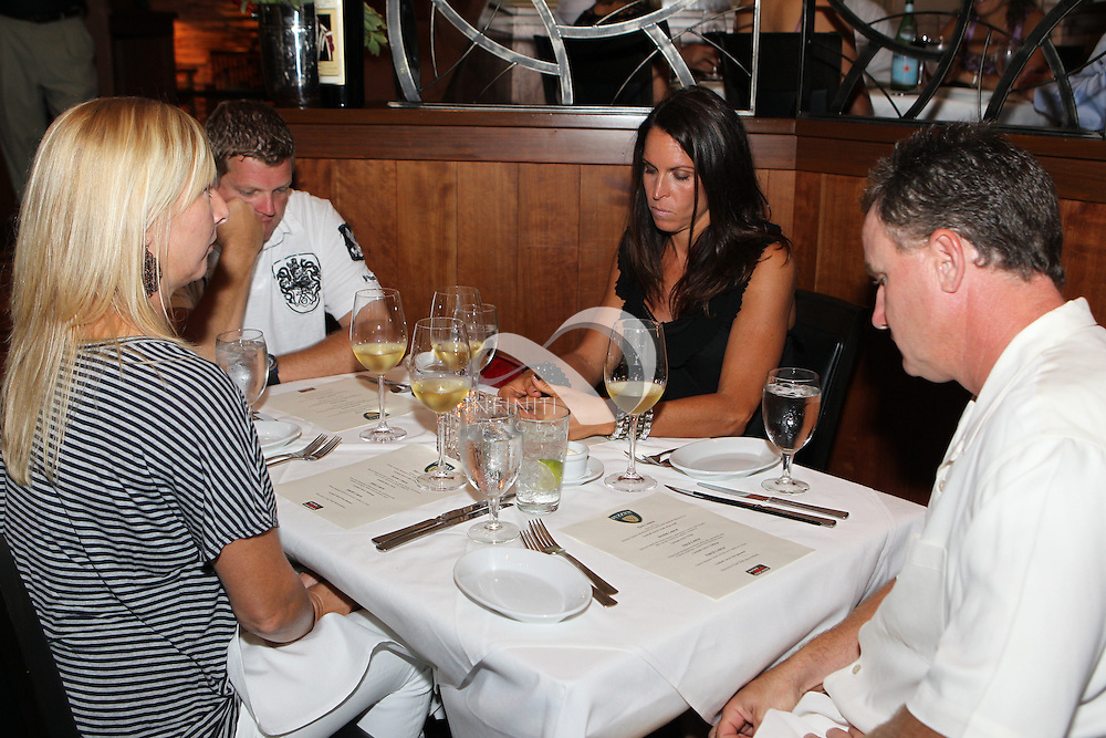 Fuzzy Zoeller makes a personal appearance promoting Fuzzy's Vodka and the Wolf Challenge at Ruth's Chris Steak House in Indianapolis, Indiana..Corporate Event photography by Michael Hickey, Infiniti Images