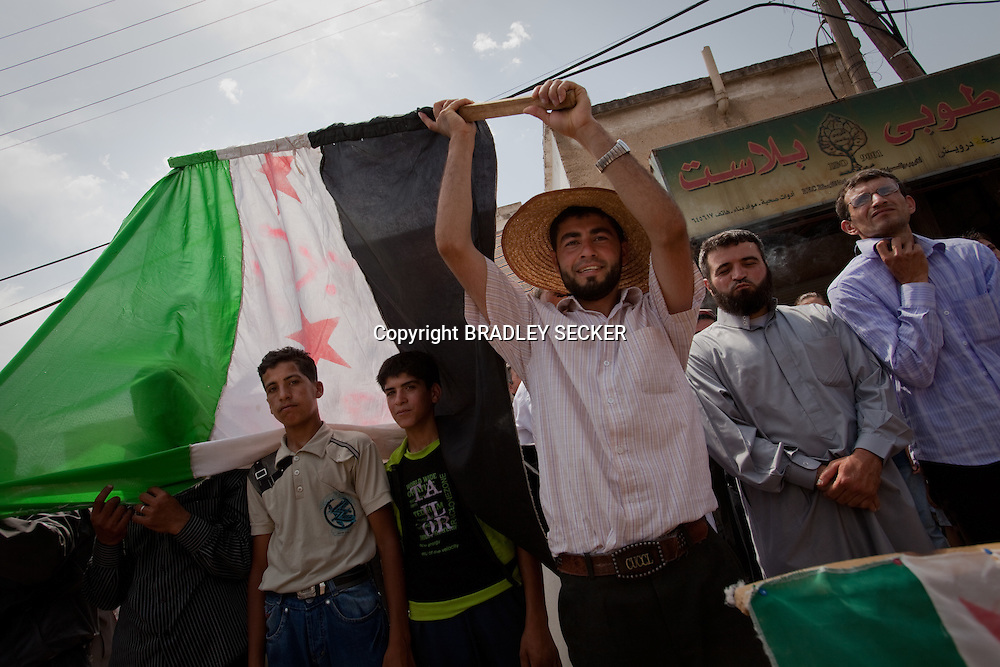 Demonstrators at an anti-government protest in al-Basheria, Idlib, Syria. The weekly demonstrations call for the regime to step down, killings to end, and for democratic change in Syria. al-Basheria, Idlib, Syria.