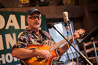 """Duane Johnson on guitar during the annual """"Duanestock"""" held in Johnson's 133 year old barn on Saturday with family and friends.  (Karen Bobotas/for the Laconia Daily Sun)"""