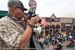 Bob Davis of Sturgis Photo And Gifts shoots his daily Main Street group photo during the  78th annual Sturgis Motorcycle Rally. Sturgis, SD. USA. Sunday August 5, 2018. Photography ©2018 Michael Lichter.