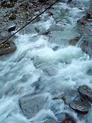 Silky blue green waters of a creek near Skykomish, on Highway 2, Washington, USA.