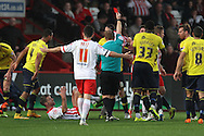 Stevenage FC midfielder Michael Tonge is shown a red card during the Sky Bet League 2 match between Stevenage and Oxford United at the Lamex Stadium, Stevenage, England on 31 October 2015. Photo by Jemma Phillips.