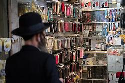 23 February 2020, Jerusalem: A Jewish man looks into a phone shop in the Jerusalem Old City.