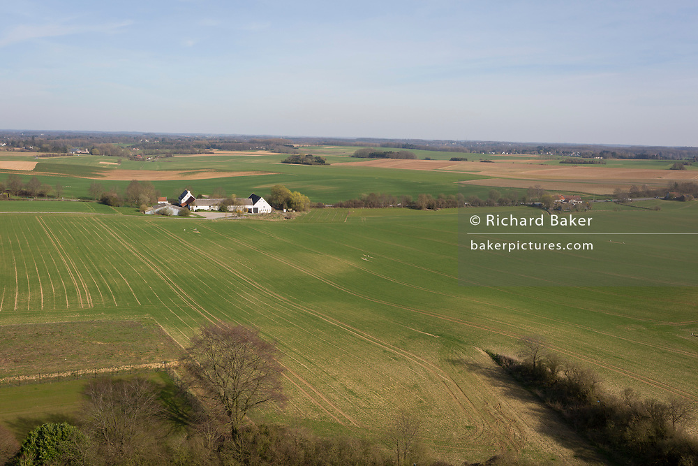The landscape of fields and farming land including La Haye Sainte farm, the location of the Battle of Waterloo, on 25th March 2017, at Waterloo, Belgium. La Haye Sainte has changed very little since it played a crucial part in the Battle of Waterloo on 18 June 1815.<br /> It was defended by about 400 British and German troops, hopelessly outnumbered by attacking French but held out until the late afternoon when they retired because their ammunition had run out. If Napoleon Bonaparte's army had captured La Haye Sainte earlier in the day, almost certainly he would have broken through the allied centre and defeated the Duke of Wellington's army. The Battle of Waterloo was fought on 18 June 1815. A French army under Napoleon Bonaparte was defeated by two of the armies of the Seventh Coalition: an Anglo-led Allied army under the command of the Duke of Wellington, and a Prussian army under the command of Gebhard Leberecht von Blücher, resulting in 41,000 casualties.