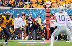 Sep 22, 2018; Morgantown, WV, USA; West Virginia Mountaineers head coach Dana Holgorsen watches a play develop during the first quarter against the Kansas State Wildcats at Mountaineer Field at Milan Puskar Stadium. Mandatory Credit: Ben Queen-USA TODAY Sports
