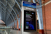 As the UK government urged that all Britons should avoid non-essential travel abroad in order to combat the Coronavirus pandemic in Britain, a digital public information ad from the government and the NHS (National Health Service) tells the public to wash their hands thoroughly, at a quiet St. Pancras rail station, the London terminus for Eurostar services to mainland Europe, on 17th March 2020, in London, England.