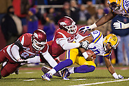 FAYETTEVILLE, AR - NOVEMBER 15:  Anthony Jennings #10 of the LSU Tigers is sacked by Deatrich Wise Jr. #48 of the Arkansas Razorbacks at Razorback Stadium on November 15, 2014 in Fayetteville, Arkansas.  The Razorbacks defeated the Tigers 17-0.  (Photo by Wesley Hitt/Getty Images) *** Local Caption *** Anthony Jennings; Deatrich Wise Jr.