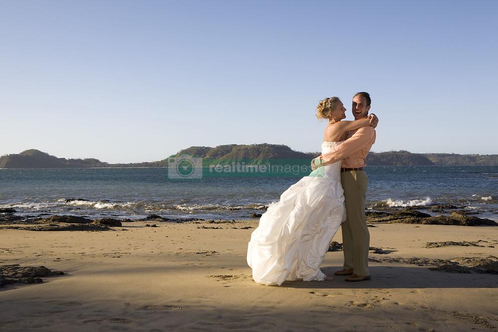 July 21, 2019 - Bride And Groom Embracing On Beach (Credit Image: © Caley Tse/Design Pics via ZUMA Wire)