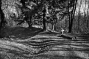 Verdun WW1 Battlefield site, Verdun-sur-Meuse, France. March 2014<br /> The graves of two unknown French Soldiers buried where they fell on the shell cratered Verdun Battlefield in 1916.<br /> The Battle of Verdun lasted 9 months, 3 weeks and 6 days between 21 February and 20 december 1916. It was the longest and one of the most costly battles in human history;  recent estimates increase the number of casualties to 976,000.<br /> <br /> Caption information below from wikipedia:<br /> The Battle of Verdun (Bataille de Verdun0, was fought from 21 February – 18 December 1916 during the First World War on the Western Front between the German and French armies, on hills north of Verdun-sur-Meuse in north-eastern France. The German Fifth Army attacked the defences of the Région Fortifiée de Verdun (RFV) and the Second Army on the right bank of the Meuse, intending rapidly to capture the Côtes de Meuse (Meuse Heights) from which Verdun could be overlooked and bombarded with observed artillery-fire. The German strategy intended to provoke the French into counter-attacks and counter-offensives to drive the Germans off the heights, which would be relatively easy to repel with massed artillery-fire from the large number of medium, heavy and super-heavy guns, supplied with large amounts of ammunition on excellent pre-war railways, which ran within 24 kilometres (15 mi) of the front-line.<br /> <br /> The German strategy assumed that the French would attempt to hold onto the east bank of the Meuse, then commit the French strategic reserve to recapture it and suffer catastrophic losses from German artillery-fire, while the German infantry held positions easy to defend and suffered few losses. The German plan was based on the experience of the September – October 1915 battles in Champagne (Herbstschlacht) when after early success the French offensive was defeated with far more French than German casualties. Poor weather delayed the beginning of the German offensive (Unternehmen Ge