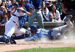 August 19, 2017 - Chicago, IL, USA - The Toronto Blue Jays' Darwin Barney (18) scores in front of Chicago Cubs catcher Alex Avila, left, on a double by Raffy Lopez during the fourth inning at Wrigley Field in Chicago on Saturday, Aug. 19, 2017. The Cubs won, 4-3. (Credit Image: © Nuccio Dinuzzo/TNS via ZUMA Wire)