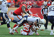 KANSAS CITY, MO - NOVEMBER 24:  Running back Ryan Mathews #24 of the San Diego Chargers fumbles the ball after getting hit by safety Eric Berry #29 of the Kansas City Chiefs during the first half on November 24, 2013 at Arrowhead Stadium in Kansas City, Missouri.  (Photo by Peter Aiken/Getty Images) *** Local Caption *** Ryan Mathews;Eric Berry