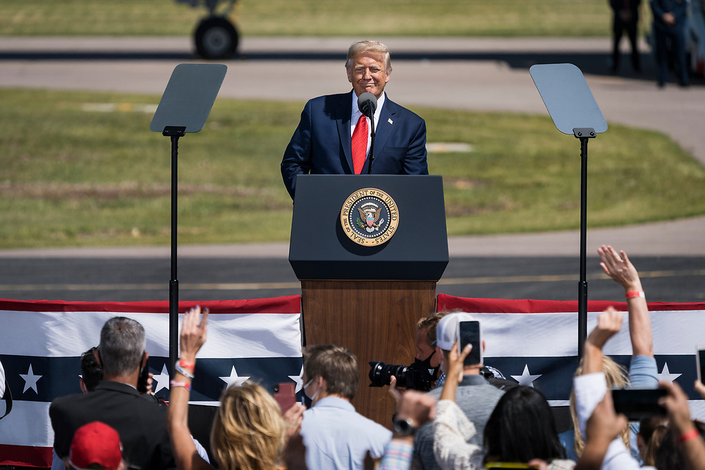 President Donald Trump smiles to the crowd during a campaign rally at North Star Aviation in Mankato, Minnesota on Monday, Aug. 17, 2020.
