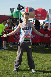 © Licensed to London News Pictures. 21/04/2013. London, England. Picture: Harry Judd of McFly. Celebrity Runners at a photocall before the start of the Virgin London Marathon 2013 race. Many wore black ribbons to pay their respect for those who died or were injured in the Boston Marathon. Photo credit: Bettina Strenske/LNP