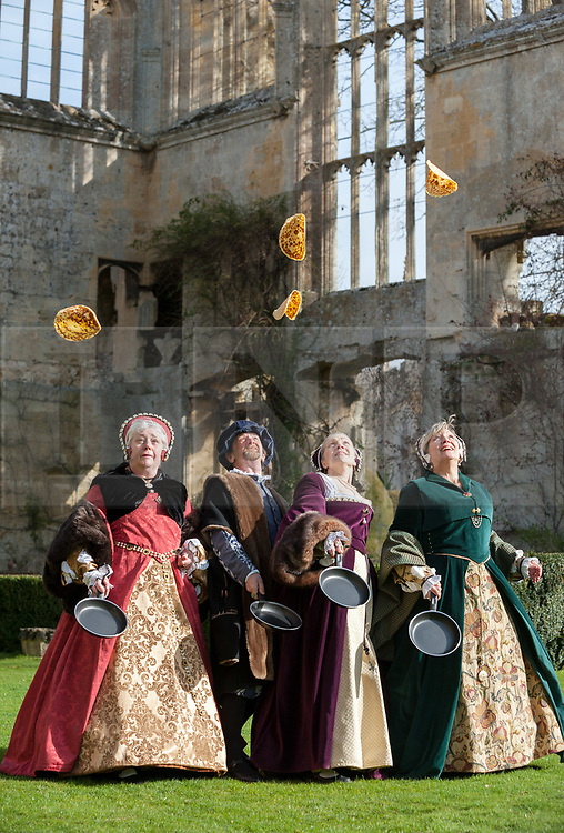© Licensed to London News Pictures. 04/03/2019; Winchcombe, Gloucestershire, UK. Pancake tossing at Sudeley Castle with historic characters including Queen Katherine Parr (in purple) and Thomas Seymour who married Katherine after Henry's death. Queen Katherine Parr was among eight historic reenactors from Past-Times Living History who visited the Castle to celebrate its reopening after being closed for winter and also marked the historic tradition of Pancake Day, which has its origins in Tudor times. The tradition of making pancakes is long, and featured in cookery books as far back as 1439. The tradition of tossing or flipping them is almost as old. The castle and gardens are now open for the season. Sudeley Castle was one of the Tudors' most treasured palaces, often housing those closest to the crown. It's where Anne Boleyn stayed with Henry VIII while he decided to dissolve the monasteries, and where Katherine Parr, Henry's last wife, lived after he died. She now lies entombed in the Castle's church. Photo credit: Simon Chapman/LNP
