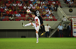 August 2, 2017 - Piraeus, Attiki, Greece - Kostas Fortounis (no 7) of Olympiacos and Everton Bilher (no 25) of Partizan vindicate the ball during the game. (Credit Image: © Dimitrios Karvountzis/Pacific Press via ZUMA Wire)