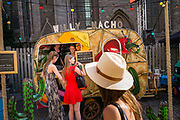 Girls ordering streetfood at Willy Nacho's foodtruck during Barrio Cantina, foodfestival, ghent, Belgium, 06.05.2016