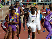 Kerron Clement of Florida (left) takes handoff from Stefan Pastor and LSU's Pete Coley receives baton from Kelly Willie on the anchor of the College Championship of America men's 4 x 400-meter relay in the 110th Penn Relays at  Franklin Field on Saturday, April 24, 2004 in Philadelphia. Florida won in a meet record 3:01.10 and LSU was second in 3:01.39.