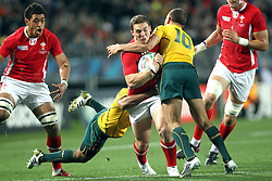 © SPORTZPICS/ Seconds Left Images 2011 - Wales' George North is stopped by Australia's Will Genia (L) & Australia's Quade Cooper (R) Wales v Australia - Rugby World Cup 2011 - Bronze Final - Eden Park - Auckland - New Zealand - 21/10/2011 -  All rights reserved..