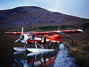 Lake Clark Air Service's de Havilland DHC3 Otter picking up hunting party from the shore of Pear Lake, Lake Clark National Preserve, Alaska.