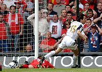 Photo: Daniel Hambury.<br />Liverpool v West Ham United. The FA Cup Final. 13/05/2006.<br />Liverpool's Jamie Carragher lies on the ground after scoring an own goal as West Ham's Yossi Benayoun runs to celebrate.