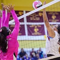 Tohatchi Cougar Latisha Halona (19) tips the ball over to the Navajo Prep Eagles Thursday at Tohatchi High School.