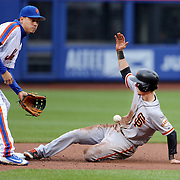 NEW YORK, NEW YORK - MAY 01: Matt Duffy #5 of the San Francisco Giants steals second as Wilmer Flores #4 of the New York Mets waits for the ball at second base during the New York Mets Vs San Francisco Giants MLB regular season game at Citi Field on May 01, 2016 in New York City. (Photo by Tim Clayton/Corbis via Getty Images)