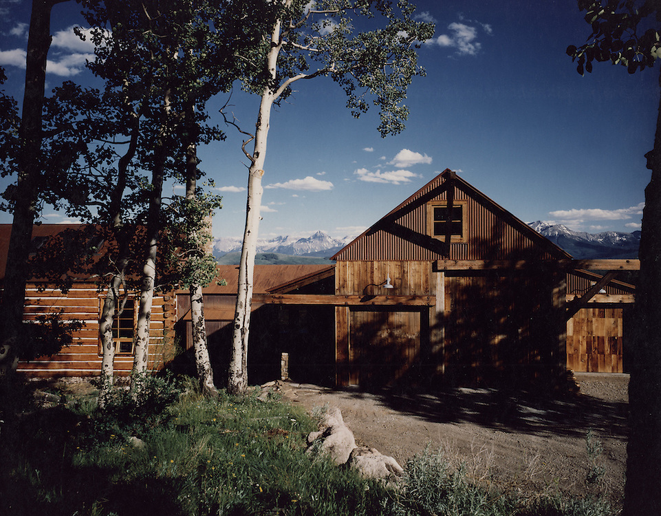 This custom home was built on a remote mesa with spectacular views of the Sneffels Range. The home consists of two forms, one of recycled logs and the other of timber and glass, with a timber and glass bridge connecting the two. I was responsible for all aspects of the Design, Construction Documents and Administration.