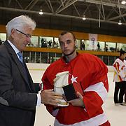 Fikri Atali, Turkey, receives the Team Fair Play award for Turkey from Kai Hietariinta, IIHF Tournament Chairman at the conclusion of the 2012 IIHF Ice Hockey World Championships Division 3 held at Dunedin Ice Stadium. Dunedin, Otago, New Zealand. 22nd January 2012. Photo Tim Clayton