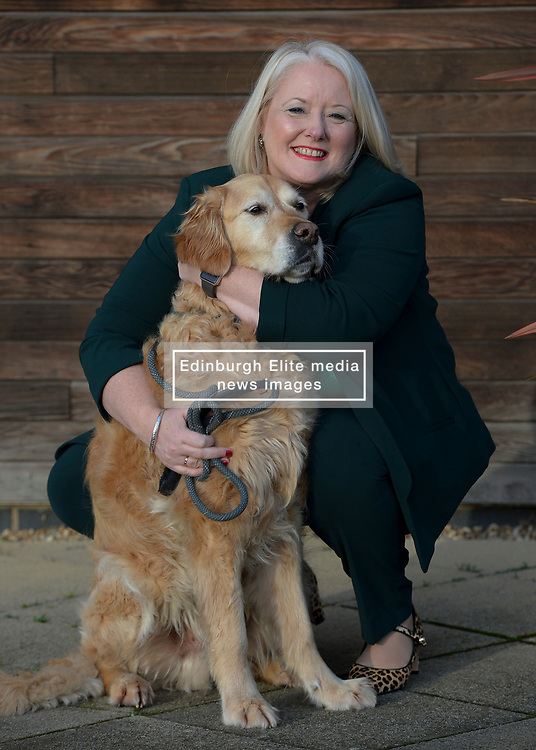 Pictured: Christina McKelvie meets Bruce, the 8 year old labrador.<br /> <br /> Equalities Minister Christina McKelvie visitied the Dogs Trust Freedom Project, a dog fostering service for people leaving domestic abuse and going into refuge. This year marks the 15th anniversary of the project, which has helped more than 1,400 people.<br /> <br /> © Dave Johnston / EEm