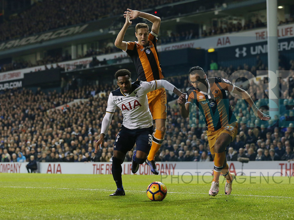Tottenham's Danny Rose tussles with Hull's Michael Dawson and Ahmed Elmohamady during the Premier League match at White Hart Lane Stadium, London. Picture date December 14th, 2016 Pic David Klein/Sportimage