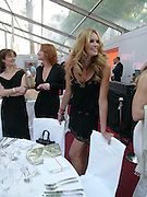 Elle Macpherson. Glamour Women Of The Year Awards 2005, Berkeley Square, London.  June 7 2005. ONE TIME USE ONLY - DO NOT ARCHIVE  © Copyright Photograph by Dafydd Jones 66 Stockwell Park Rd. London SW9 0DA Tel 020 7733 0108 www.dafjones.com