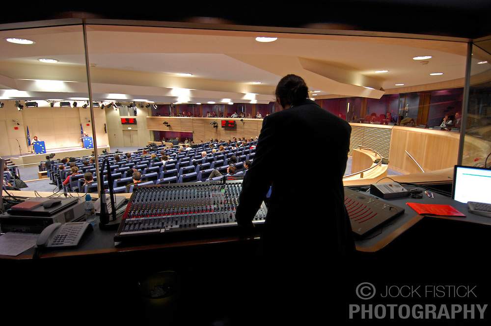 """BRUSSELS, BELGIUM - NOV-29-2006 - Maximilien Mansutti, """"le Register de Conference"""" coordinates all the audio and video feeds in the audi-video control room for the translators booths at the EU Commission HQ press room. (PHOTO © JOCK FISTICK)<br />"""
