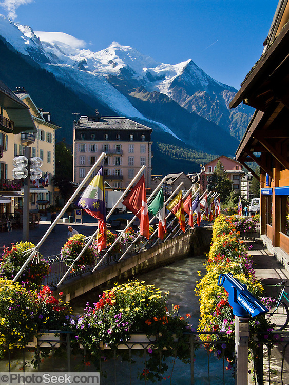 International flags fly over the River Arve in Chamonix, France, beneath Mont Blanc (4808 meters or 15,774 feet), the highest peak in Western Europe.