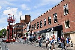 Zipwire street entertainment as part of the Mayor's Festival celebration, Norwich UK July 2017