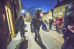 Police take part in an operation against drug dealers in the Stirling area early this morning. Police seen leaving flats in Stirling.