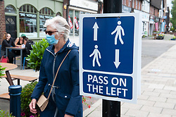 ©Licensed to London News Pictures 04/07/2020     <br /> Petts Wood, UK. A covid-19 arrow sign directing people to pass on the left is tied to a lamp post in Petts Wood High Street,South East London. As coronavirus lockdown is easing people are expected to wear protective face masks and keep a social distance from people outside their bubbles. Photo credit: Grant Falvey/LNP
