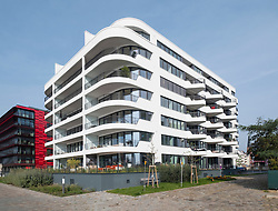 Luxury apartment building on Osthafen , East Harbour at Mediaspree along River Spree in Berlin , Germany