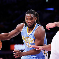 23 November 2014: Denver Nuggets forward Kenneth Faried (35) drives past Los Angeles Lakers center Robert Sacre (50) during the Los Angeles Lakers season game versus the Denver Nuggets, at the Staples Center, Los Angeles, California, USA.